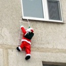 Funny Santa on the wall of a house